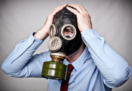 Office Worker in Gas Mask
