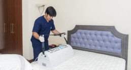 A mattress being cleaned and sanitised using an UV machine