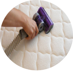 Close up of a mattress being deep vacuumed prior to being sanitised